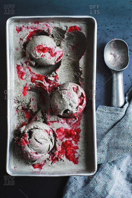 Black sesame seed ice cream with strawberry swirl