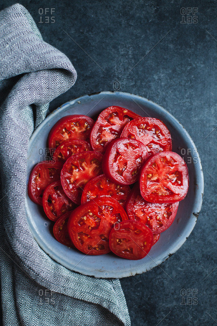 red tomatoes on blue plate