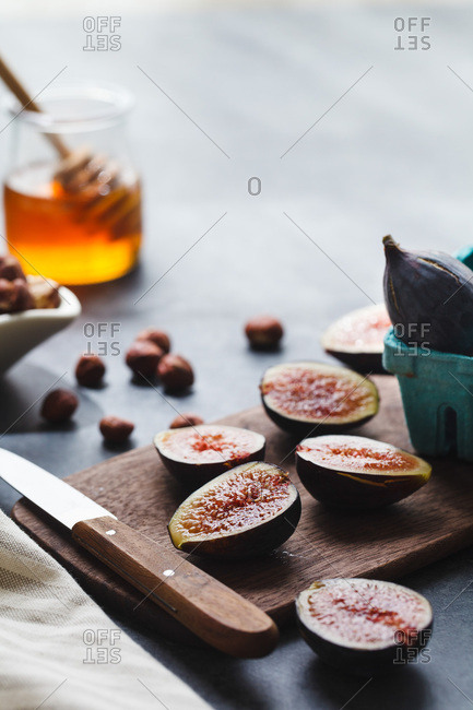 Figs and honey on cutting board