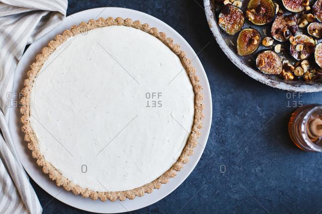 Cheesecake tart on blue background