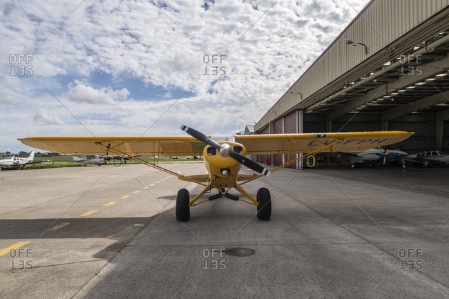 Private plane parked outside of hanger