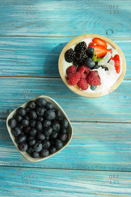 Top down view of assorted berries served with yogurt