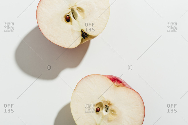 Apple sliced in half on white background