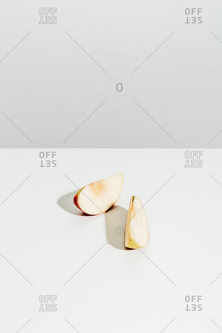 Sliced pieces of apple on white background