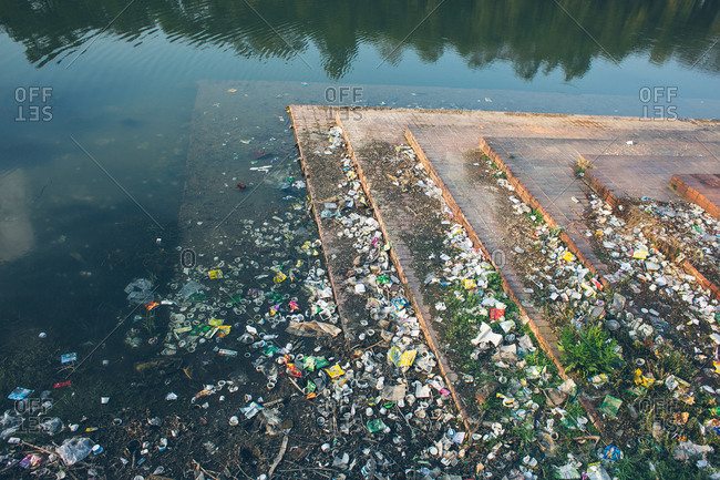 Large amount of plastic and other garbage littering water way in Bangladesh