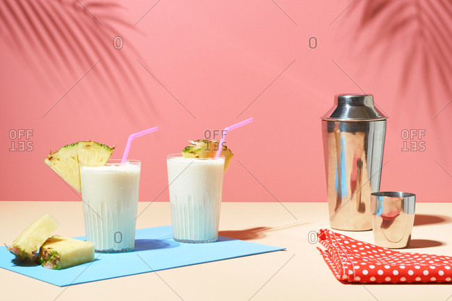 Pina colada drinks on pastel background