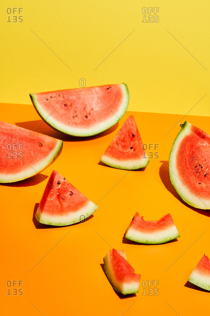 Watermelon wedges on orange and yellow background