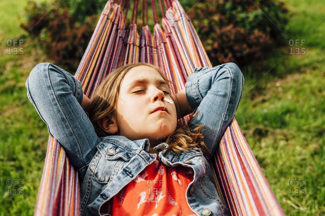 Portrait of little girl relaxing in hammock
