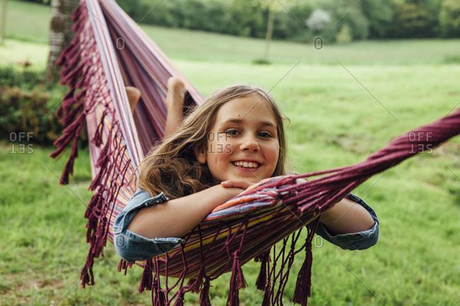 Portrait of happy girl lying in hammock