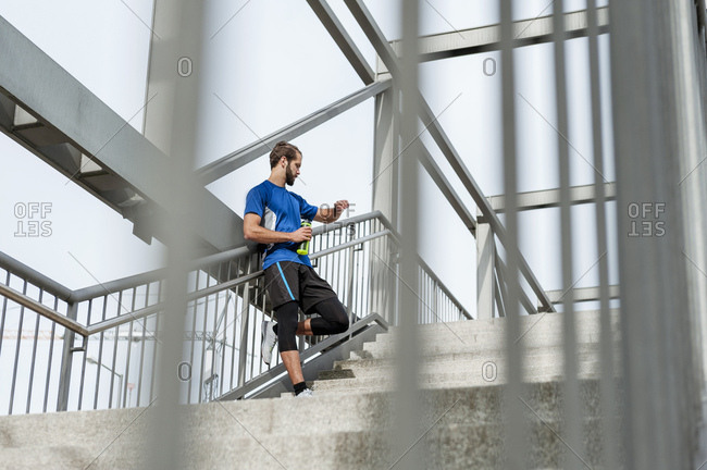 Man on stairs having a break from running