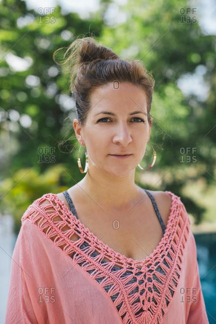 Portrait of a brunette woman outdoors