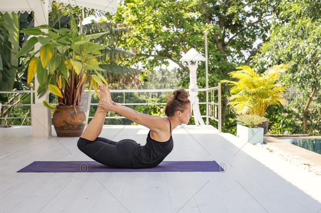 Woman practicing yoga on terrace