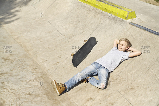 Boy relaxing in skatepark