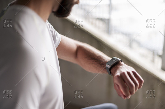 Athlete checking the time on a smartwatch