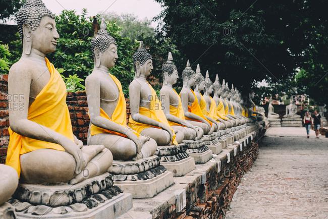 Thailand- Bangkok- Ayutthaya- Buddha statues in a row in Wat Yai Chai Mongkhon