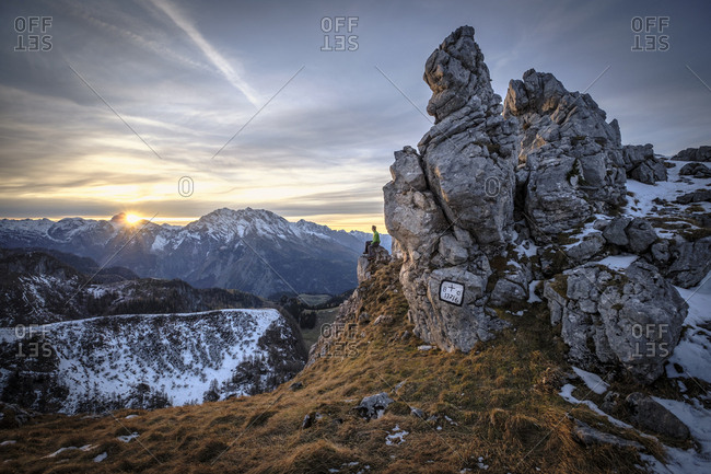Germany- Bavaria- Berchtesgaden Alps- View to Schneibstein- hiker sitting on viewing point at sunset