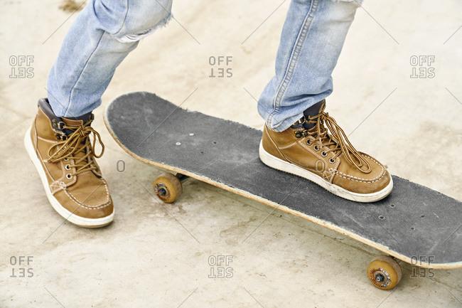 Feet on skateboard