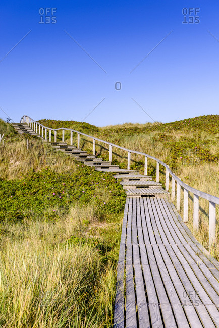 Germany- Schleswig-Holstein- Sylt- wooden walkway through dunes