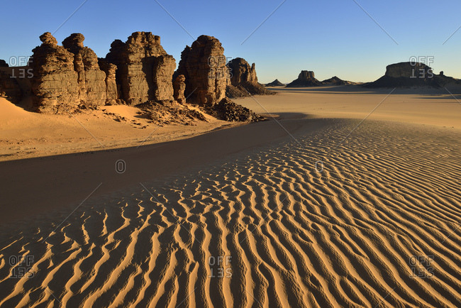Africa- Algeria- Sahara- Tassili N'Ajjer National Park- Tadrart- Rock towers and sand dunes in Tiou Tatarene