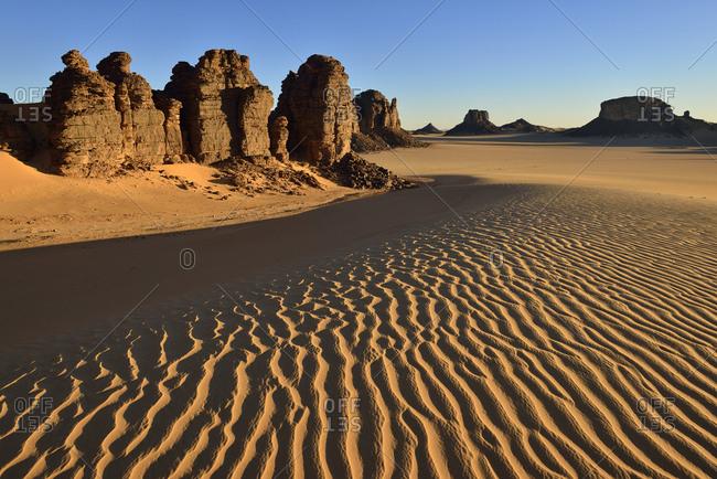 Africa- Algeria- Sahara- Tassili N'Ajjer National Park- Tadrart- Rock towers and sand dunes in Tiou Tatarene