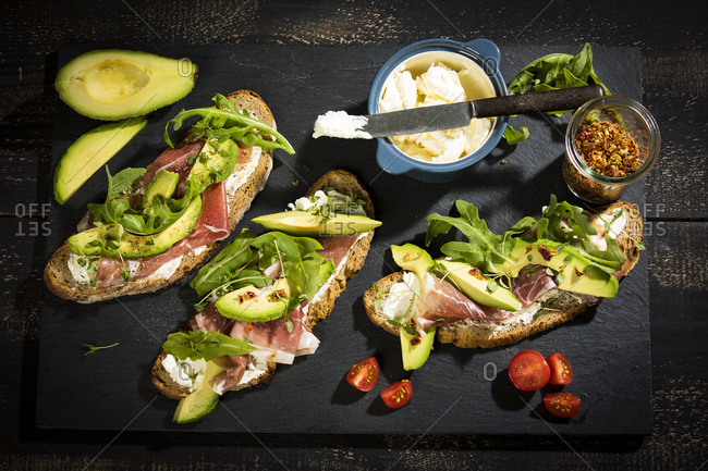 Onion bread with cream cheese- parma ham- avocado- rucola- thyme and tomato