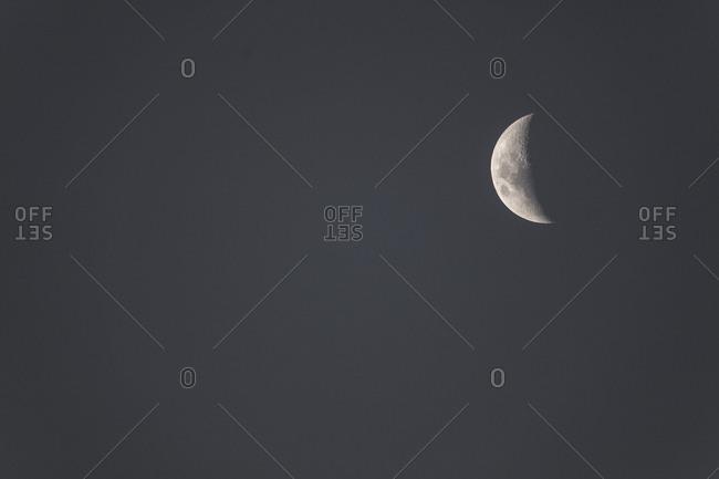 Night sky with half moon
