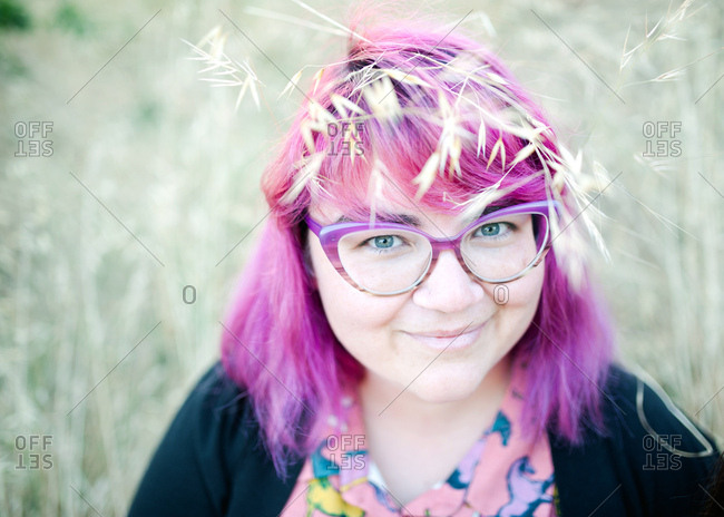 Close up of a woman with pink hair