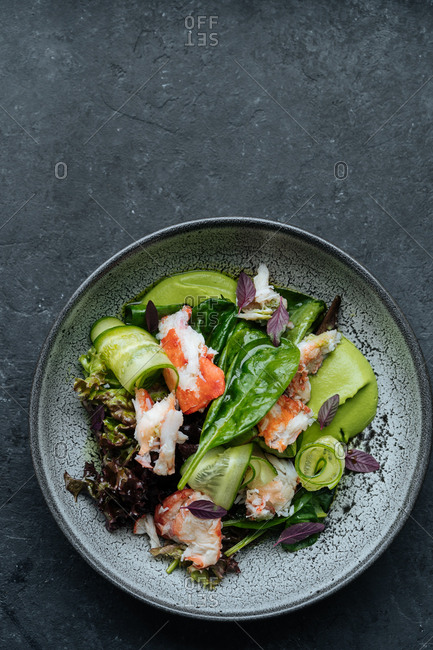 Top view of ceramic bowl with Nordic salad ingredients