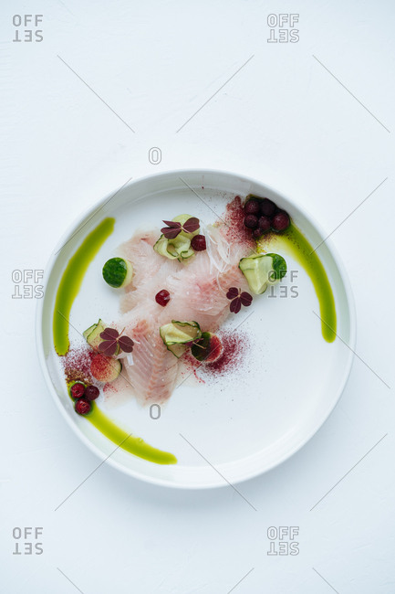 Top view of vibrant fruity seafood on round plate