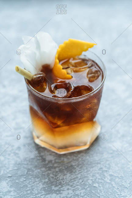 Refreshing alcoholic beverage with orange rind