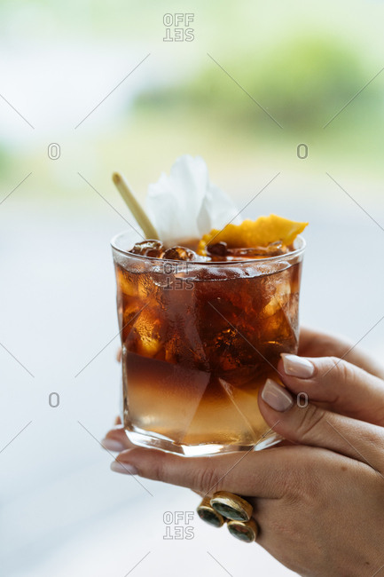Woman drinking dark summer cocktail