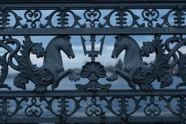 Sculpted horses on ornate gate details