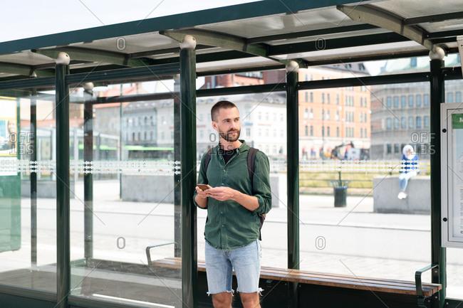 Man wondering alone in bus stop