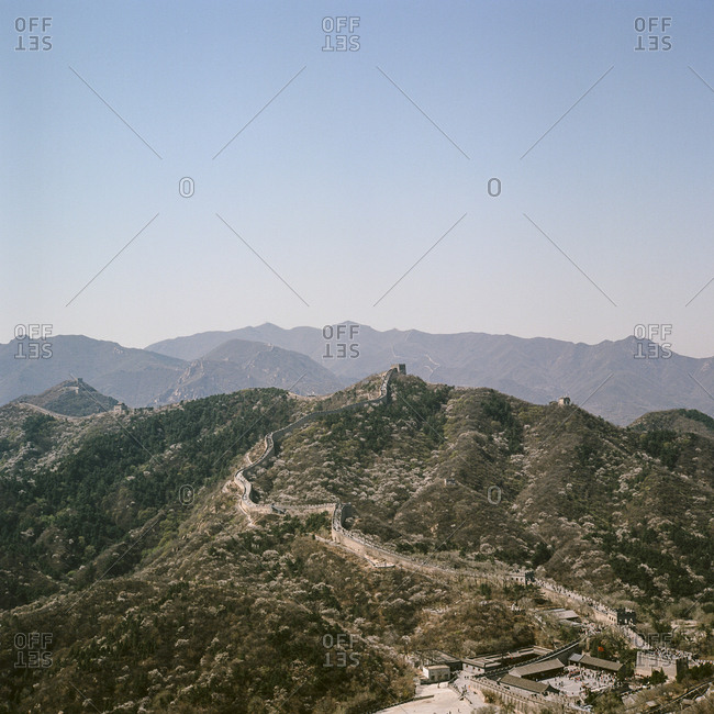 Panoramic view of great wall of China snaking over hills