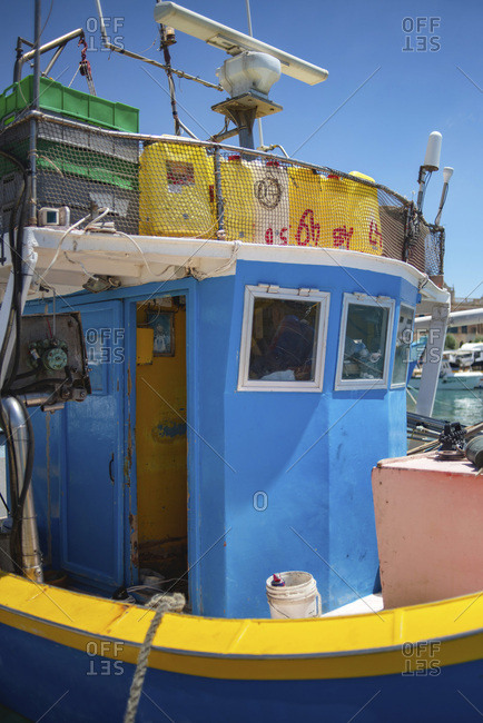 Close up of wheel house of traditional wooden boat in harbor