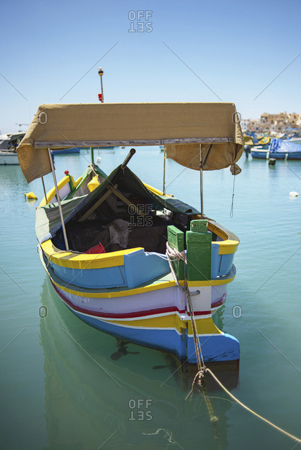 Single traditional painted boat moored in harbor