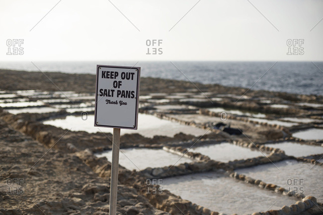 Sign warning visitors to keep out of salt pans on coast