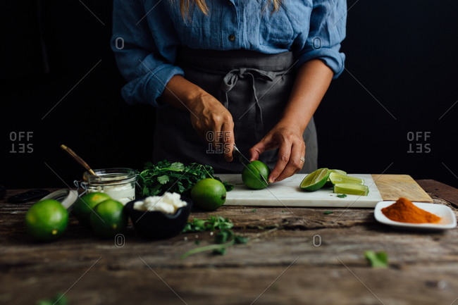 Woman cutting limes