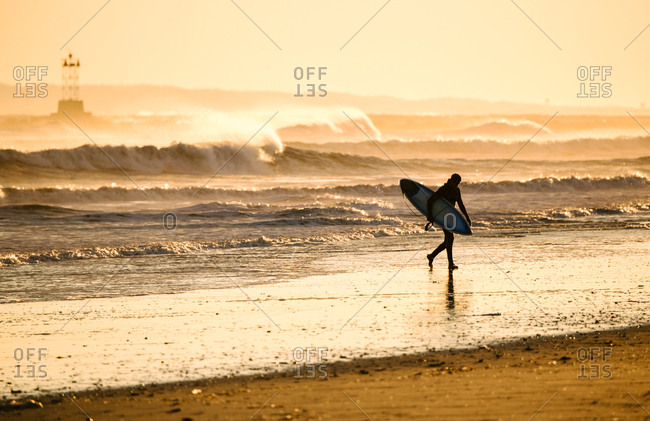 A surfer on a cold afternoon at Rockaway Beach