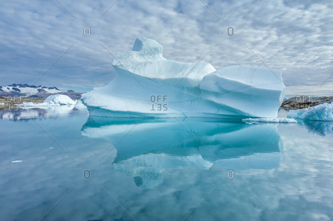 Sculpted icebergs and reflections in Semerlik Fjord
