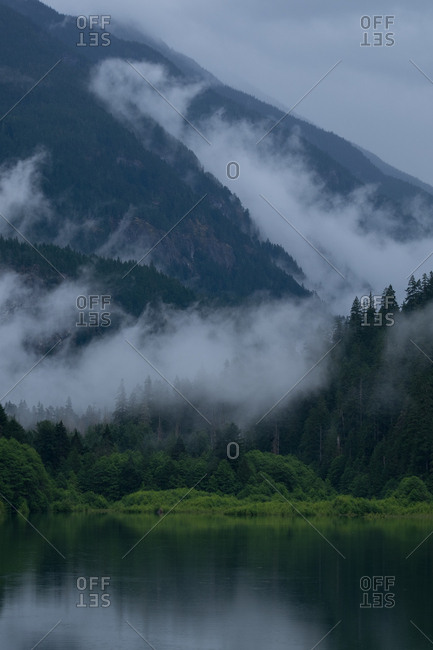 Mist shrouds the mountain slopes over Diablo Lake in North Cascades National Park