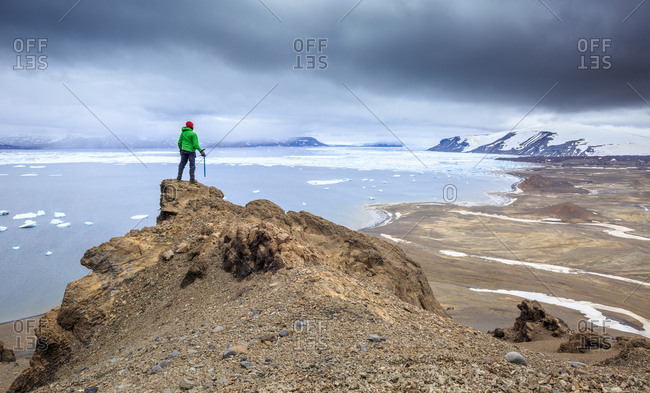 A mountaineer contemplating the view in Antarctica
