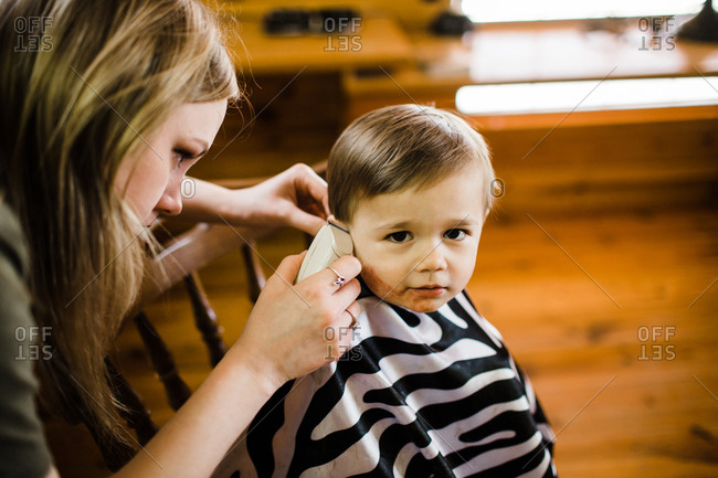 Aunt cutting toddler nephew's hair
