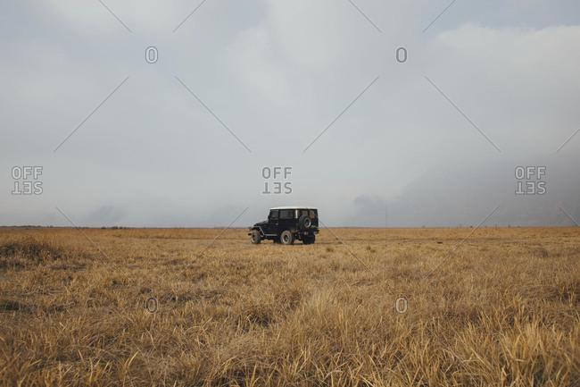 Mount Bromo, Indonesia - September 13, 2015: Single 4x4 car in grasslands of Bromo National Park