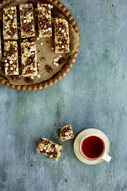 Pecan white chocolate breakfast bars served with hot tea