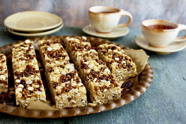 Pecan white chocolate breakfast bars served on plate