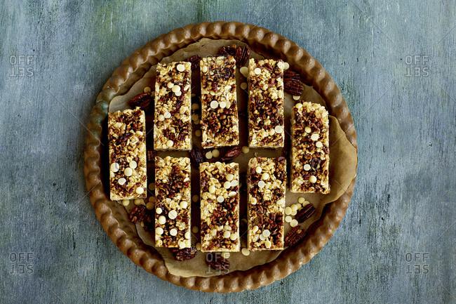 Freshly baked pecan white chocolate breakfast bars served on a platter