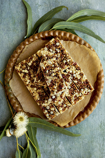 Freshly baked pecan white chocolate breakfast bars served on a plate