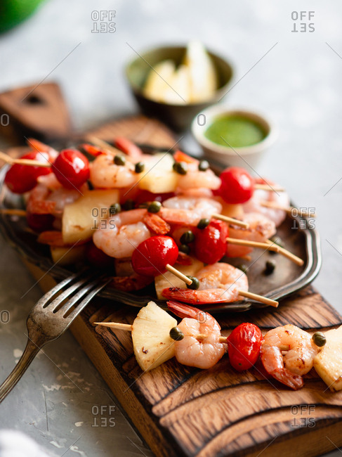 Grilled shrimp skewers with cherry tomato and pineapple