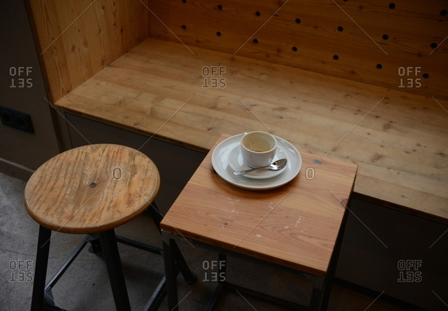 Empty coffee cup on wooden table